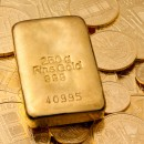 gold_bar_coins_shutterstock_58351120_medium