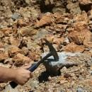 geo_hammering_rock_shutterstock_37715773_medium